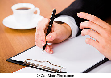 Before writing a contract - Photo of businesswoman�s hands...