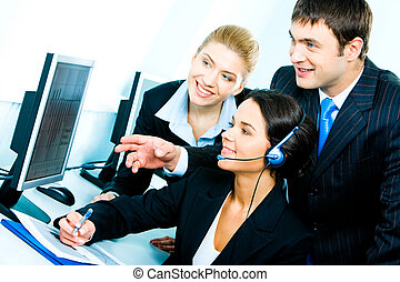 Computer work - Photo of group of confident businesspeople...