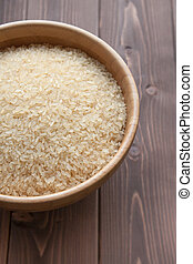 Rice - Bowl of white rice on wood table