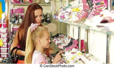 Choosing Shoes in Shoe Store