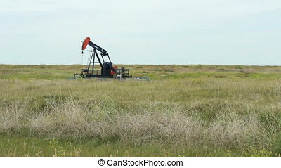 Oil Pump - A lonely oil pump works tirelessly on the barren...