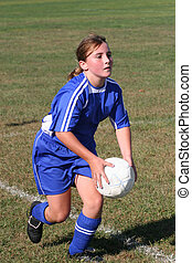Soccer Player in Action - Teen Youth Soccer Player getting...