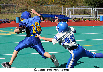 Youth Football Tackle Play during game.