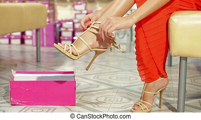 Woman Trying On High Heels - Young Woman Trying On High...