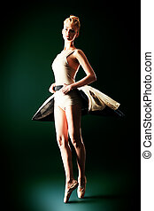 abilities - Beautiful ballet dancer posing at studio.