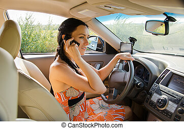 Woman driver talking on her mobile