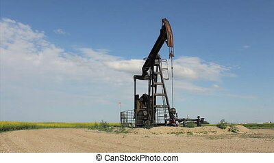 Oil Pump On Canadian Prairies - A lonely oil pump works...