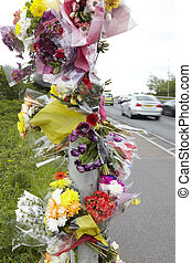 Floral Tributes At Site Of Road Traffic Accident