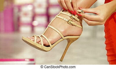 Trying On High Heels - Young Woman Trying On High Heels In...