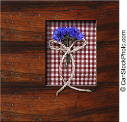 wooden frame background with blue flowers