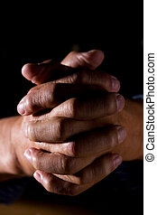Praying man - A shot of a praying senior man