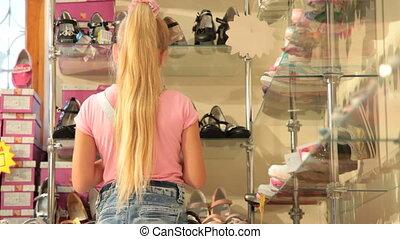 Children's Shoe Store - Child Choosing Shoes in Shoe Store
