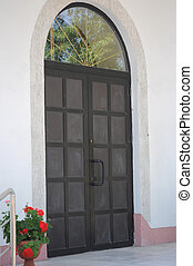 modern wooden door with glass panes and arches