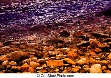 Colorful Lakeshore - a rocky lakeshore in purple and gold
