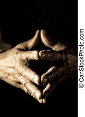 Senior hands - A shot of a senior man with clasped hands in...