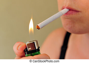 Smoking - Concept photo of a woman smoking a cigarette.