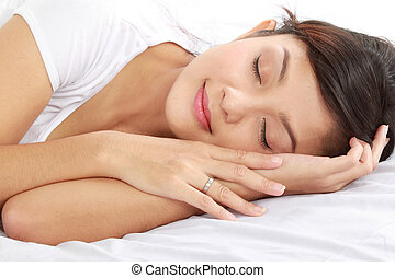 young female sleeping - lovely young female sleeping on the...