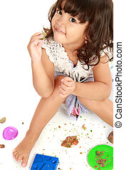 little girl with her clay