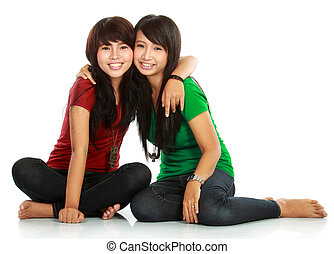 Two teenage girls best friend - portrait of attractive two...