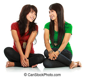 Two girls looking each other - portrait of attractive two...