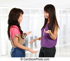 two young woman talking