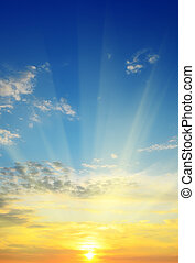 beautiful sunrise - the sun rays illuminate the sky above...