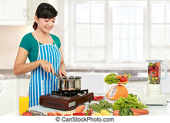 woman cooking - Beautiful woman cooking something in the...