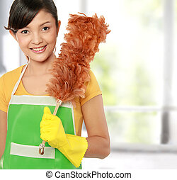 woman with cleaning sweep - picture of beautiful woman with...