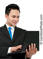 business man using laptop - young business man using laptop...