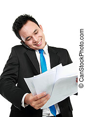 businessman holding a report - Young businessman holding a...