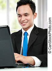 young business man with a laptop - Portrait of a handsome...