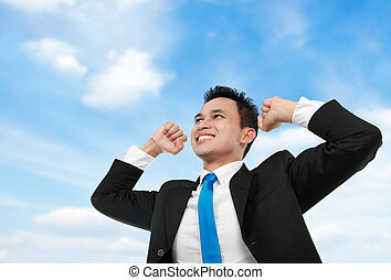 business man with arms raised under the blue sky - Cheerful...