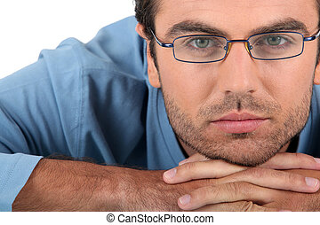 Bored man wearing glasses