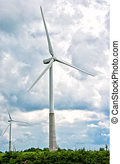 Two wind turbines on a cloudy sky background