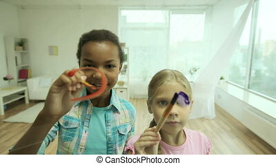 Unlimited creativity - Creative girls painting on the glass...