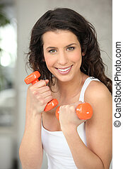 Woman with orange weights