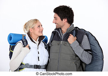Hiking couple with kit