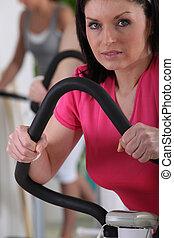 a woman doing cardio machine
