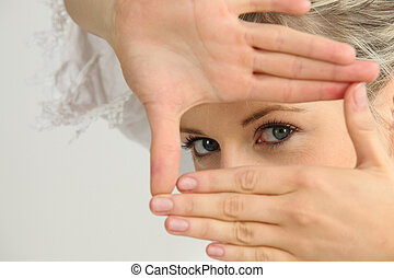 woman miming rectangle with her hands
