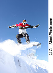A snowboarder gliding through the air