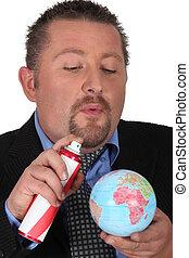 Man spraying globe