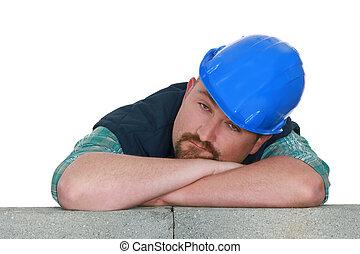 Bored tradesman at work