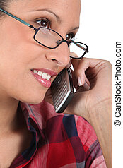 Woman with glasses on the phone