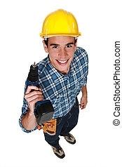 Carpenter stood with cordless drill