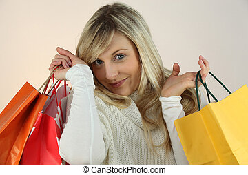Blonde woman with bags