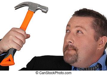 Businessman holding hammer