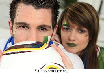 Couple supporting the Italian football team