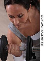 Woman working out with a barbell