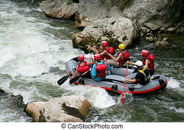 Thrill seekers rafting down rapids