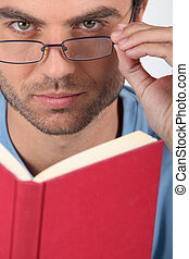 Man with glasses reading